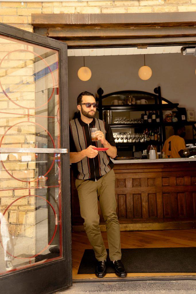 Daniel Habashi leans against the doorway to Manita, a restaurant in Toronto.