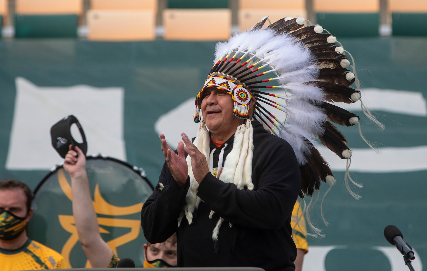 Chief Randy Ermineskin, of the Ermineskin Cree Nation in Alberta, offers a prayer before an Edmonton Elks game.