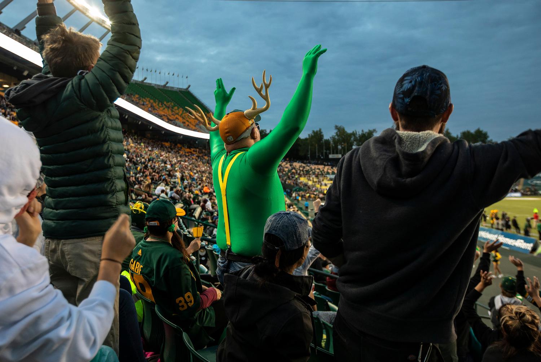 Edmonton Elks fans cheer in the stands.