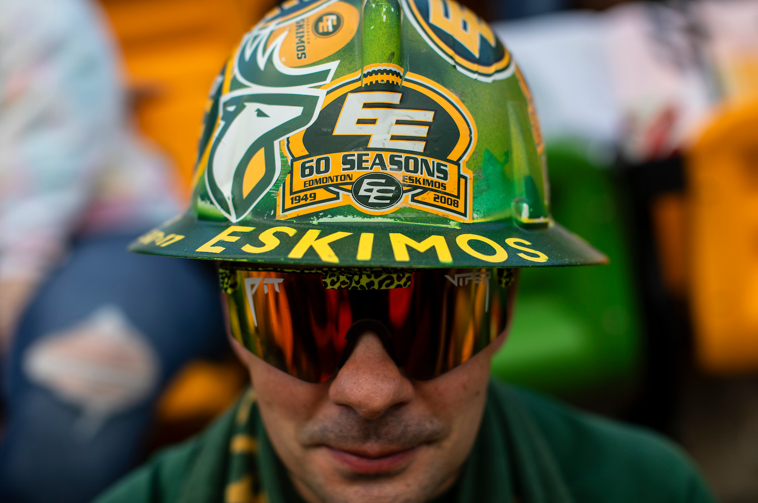 An Edmonton Elks fan wearing a hat with the team's old name.