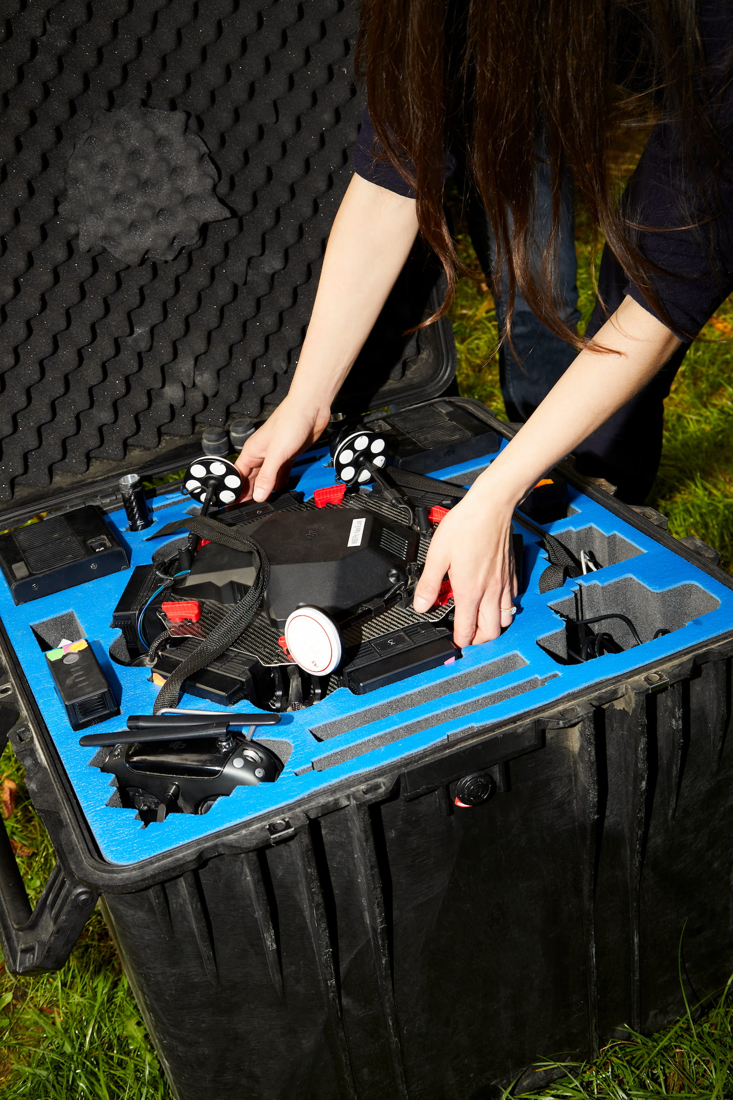 A close-up shot of a person taking a drone out of its case.