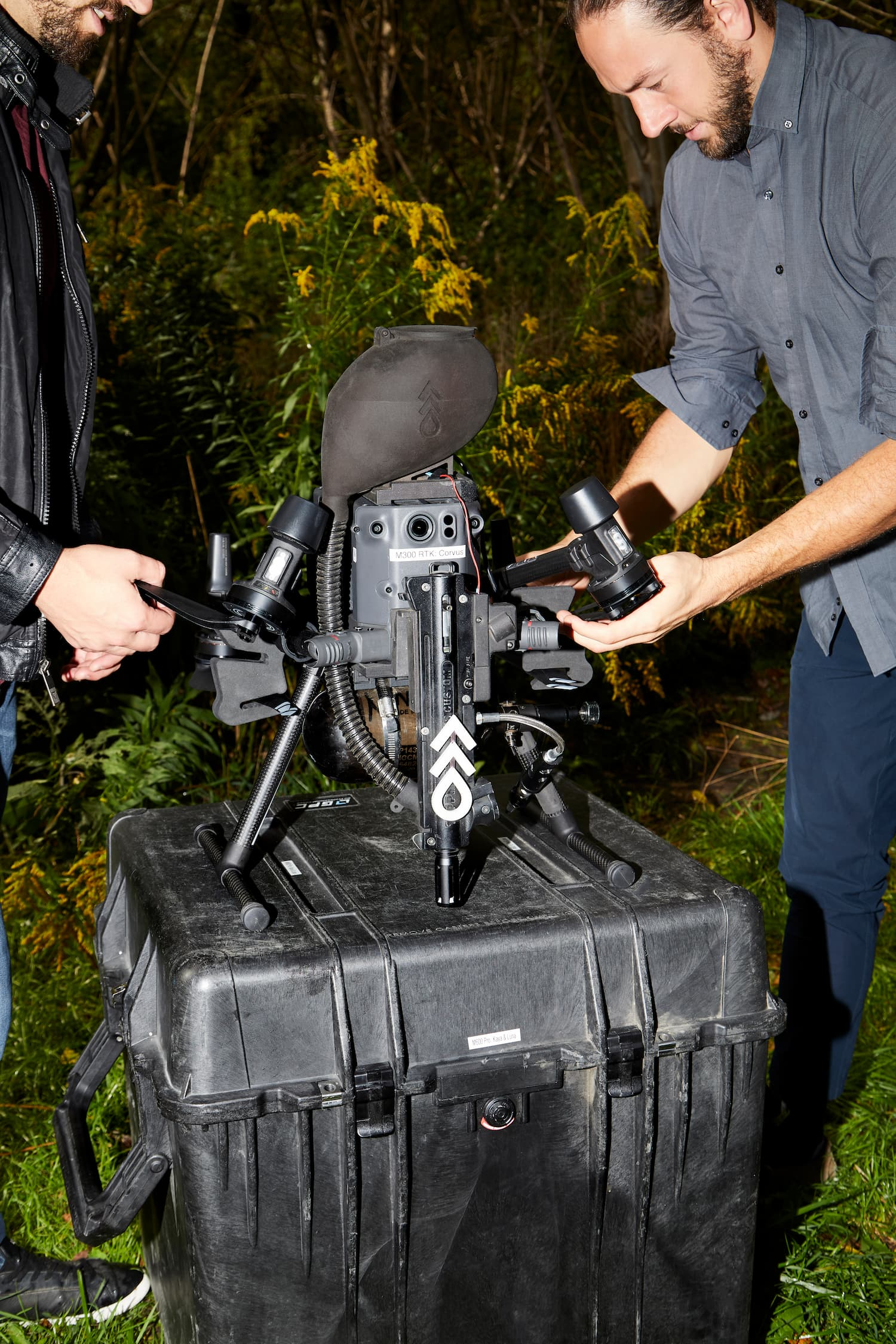 A Flash Forest drone being prepared for takeoff by two of its founders.