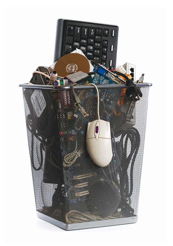 A transparent trash can filled with electronic waste